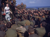 Uso Performer Entertaining a Crowd of Soldiers Aboard a Troop Transport Ship Photographic Print by Carl Mydans