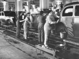Women Washing Off the New Assemble Vehicles at the Fiat Auto Factory Premium Photographic Print by Carl Mydans