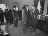 President John F. Kennedy and R. Sargent Shriver Greeting People at White House Photographic Print