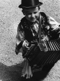 Young Mezokovesd Citizen, Carrying an Accordian Premium Photographic Print