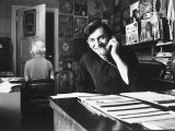 Bill Graham, Owner of Filmores East and West, Talking on Phone as He Works in His Office Premium Photographic Print by John Olson