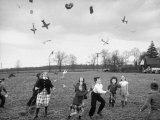 Children Trying to Catch Toys That Were Released by a Kite in the Air Premium Photographic Print by Bernard Hoffman