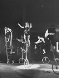Unicyclists Performering at the Circus Photographic Print