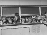Packed School Bus in Detroit, First Graders Happily Stuck their Heads Out of its Windows Premium Photographic Print
