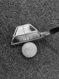 Golf Club with Mirror on Head Being Used to Help Accuracy of Golfer's Shot Photographic Print by Bernard Hoffman