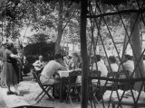 People Eating a Meal at the Outdoor Pescatore Restaurant Premium Photographic Print by Dmitri Kessel