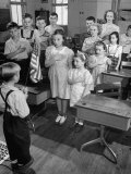 Children Reciting the Pledge of Allegiance as a Boy Holds the Us Flag in their Classroom Photographic Print by Bernard Hoffman