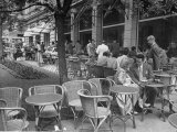 People Eating at a Sidewalk Cafe Next to the Excelsior Hotel Premium Photographic Print by Dmitri Kessel