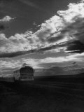 Greyhound Bus Driving Down Highway 30 Photographic Print by Allan Grant