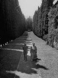 Art Expert Bernard Berenson Strolling Through His Garden with Secretary Nicky Mariano Premium Photographic Print by Dmitri Kessel