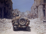 American Jeeps Travelling Through Completely Bombed Out Town During the Drive Towards Rome, Wii Premium Photographic Print by Carl Mydans