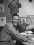 Tom Lea Jr. Sitting at His Desk Premium Photographic Print by Alfred Eisenstaedt