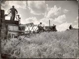 Kansas Farmer Driving Farmall Tractor as He Pulls a Manned Combine During Wheat Harvest Photographie par Margaret Bourke-White