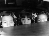 Little Girls Peeking over Rim of Table at California Chinese Mission School Premium Photographic Print by Alfred Eisenstaedt