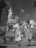 Two Women Standing in Front of a Statue of the Empress Josephine on the Island of Martinique Photographic Print