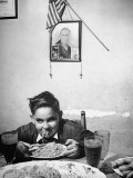 Boy Eating Spaghetti under Picture of His Brother Who Died During Invasion of Sicily Premium Photographic Print