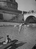 People Sunbathing and Swimming at the Tiber Boathouse Premium Photographic Print by Dmitri Kessel