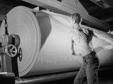 Man Working at Roller in Paper Factory Premium Photographic Print by Margaret Bourke-White