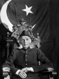 First Gov. Gen. of Independent Pakistan Mohammed Ali Jinnah Sitting in Front of Pakistani Flag Premium Photographic Print by Margaret Bourke-White