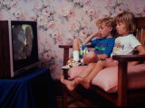 """Jackson and Elizabeth Watching Videotape of """"Mowgli and His Brothers"""" Premium Photographic Print by Ted Thai"""