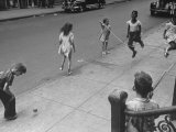 Children Jumping Rope on Sidewalk Premium Photographic Print by Ed Clark