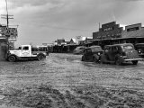 Muddy Main Street in Oil Boomtown Premium Photographic Print by Carl Mydans
