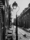 Old Fashioned Street Light in Elfreth's Alley Premium Photographic Print by Andreas Feininger