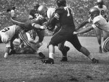 Duke Football Players Tackling the Other Team Players During a Game Photographic Print
