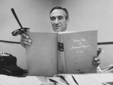 "Shirley Povich Holding Up His Book ""Who's Who of American Women"" Premium Photographic Print by Ed Clark"