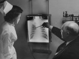 Doctors Examining X-Ray with Nurse Premium Photographic Print