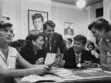 John F. Kennedy with Brother and Sisters Working on His Senate Campaign Photographic Print by Yale Joel