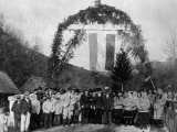 Russian Peasants Standing under Arch They Constructed to Welcome Hungarian Troops to Ruthenia Premium Photographic Print