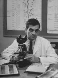 Cancer Specialist Dr. Ernest L. Wynder at Microscope in His Office Premium Photographic Print by Alfred Eisenstaedt