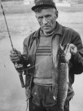 Fisherman Lauri Rapala, Who Handmakes Fishing Lures, with a Fish He Caught Premium Photographic Print