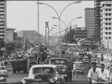 Center of Busy City with Traffic Premium Photographic Print