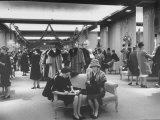 Shoppers in the Women&#39;s Coat Dept. of Saks Fifth Ave. Department Store Photographic Print by Alfred Eisenstaedt
