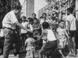 Prime Minister Kuan Yew Lee Talking to Children While Visiting a Housing Project Premium Photographic Print