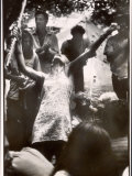 Hippie Girl Enthusiastically Playing Flute and Dancing at Woodstock Music Festival Photographic Print