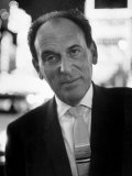 Portrait of Playwright Moss Hart Standing in the Middle of Times Square Premium Photographic Print by Alfred Eisenstaedt