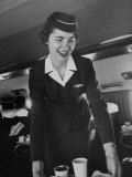 Airline Stewardess Seving Coffee Photographic Print by Peter Stackpole