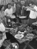 Young Married Couples Enjoying a Backyard Buffet Feast , Featuring Spaghetti Photographic Print by Nina Leen