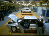 Workers Manning &quot;Skillet&quot; Equipped Saturn Assembly Line at Saturn Plant Premium Photographic Print by Ted Thai