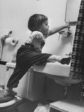 Lori Mckone in Bathroom Reaching for Toothbrush Photographic Print