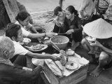 Chinese Family Having Dinner Somewhere in the City Premium Photographic Print by Carl Mydans