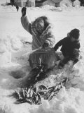 Eskimo Woman Showing Grandson How to Fish Through the Ice Premium Photographic Print by Ralph Crane