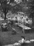 Family Picnic, a Few Grown-Ups and Many Children, Sitting on Garden Chairs Premium Photographic Print