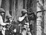 American Soldiers Firing Back at Unseen German Sniper During the Battle for Cisterna Premium Photographic Print