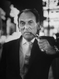 Portrait of Playwright Moss Hart, Smoking Pipe While Standing in the Middle of Times Square Premium Photographic Print by Alfred Eisenstaedt