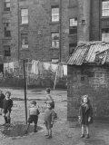 Children Playing on Slum Street in the City Premium Photographic Print