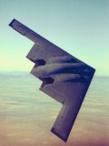 B-2 Stealth Bomber Flying over Desert-Like Landscape Photographic Print
